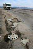 Pothole. Broken asphalt pavement resulting in a pothole, dangerous to motorists Stock Photo