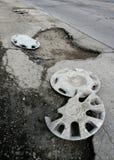 Pothole. Broken asphalt pavement resulting in a pothole, dangerous to motorists Stock Image