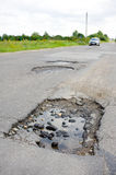 Pothole in asphalt road Stock Image