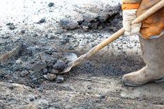 Pothole die de werken herstelt Stock Fotografie