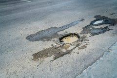 Pothole on the road Royalty Free Stock Image