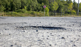A pothole in the road Stock Photography