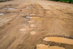 Pothole on the road. Pothole on the soil road Stock Images