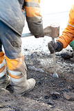 Pothole and road surface repairing Stock Image