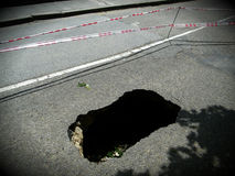 Pothole / Sinking hole Royalty Free Stock Image