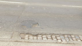 Pothole on the street stock footage