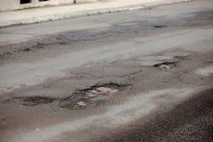 potholes stock afbeelding