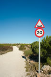 Potholes ahead. Warning sign on a scenic dirt road royalty free stock photos