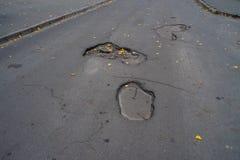 Potholes in asphalt stock photography