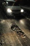 Potholes bij nacht Stock Afbeelding