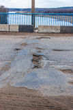 Potholes on the bridge. Bad road. Royalty Free Stock Photos
