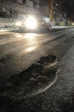 Potholes with car. Potholes and bad roads nake driving at night dangerous Stock Photos