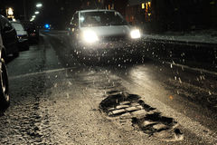 Potholes with car at night Stock Image