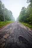 Potholes on a Country Road Royalty Free Stock Photos