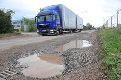 Potholes. Frankfurt, Germany - September 9, 2010 - Potholes in damaged street during fall with truck Royalty Free Stock Images