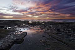 Potholes at Hospitals Reef La Jolla. Tidal pools are revealed during low tide at Potholes at Hospitals reef in La Jolla, California, USA Royalty Free Stock Images