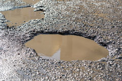 Potholes On Asphalt Road Filled With Water Stock Image