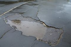 Potholes in Rain royalty free stock photography