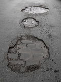 Potholes/wegschade Royalty-vrije Stock Afbeelding