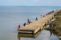 Poti, Georgia - 29 04 2018: Рыболовы на озере Paliastomi Стоковое фото RF