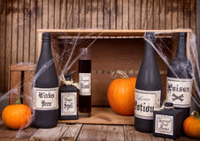 Potion bottles with pumpkins Stock Photos
