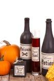 Potion bottles with pumpkins Stock Photos