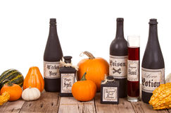 Potion bottles with pumpkins Stock Images