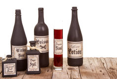 Potion bottles on wooden crates Stock Images