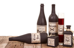 Potion bottles on wooden crates Royalty Free Stock Image