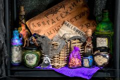 Potions with a potion and props for fortune telling. On a table by a witch Royalty Free Stock Photos