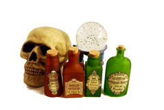 Potions, skull and skull. Bright colorful bottles of potions, Skull and Crystal ball for seeing into the future Stock Photography