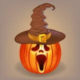 Potiron astucieux dans un chapeau de sorcière pour Halloween Photo libre de droits