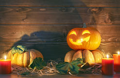 Potiron, bougies et feuilles d'automne principaux Photo libre de droits