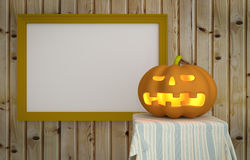 Potiron de Halloween avec le fond en bois Image stock