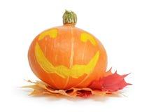 Potiron de Halloween avec le visage drôle Photographie stock libre de droits