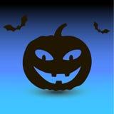 Potiron de Hallowen avec des battes sur le fond bleu Image stock