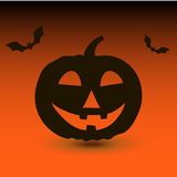 Potiron de Hallowen avec des battes sur le fond orange Photographie stock libre de droits