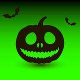 Potiron de Hallowen avec des battes sur le fond vert Images libres de droits