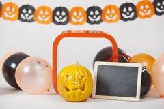 Potiron et tableau noir de Halloween Image stock