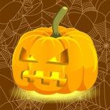 Potiron rougeoyant de Halloween avec le visage mauvais Photos libres de droits