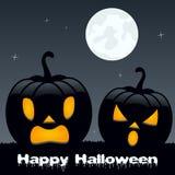 Potirons effrayants de Halloween sur l'herbe Images libres de droits