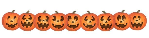 Potirons heureux de Halloween dans une rangée Photo libre de droits
