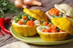 Potirons ronds de buisson cuits au four avec le plan rapproché de légumes Images stock