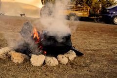 Potjie on the fire. Potjie pot, a traditional cast Iron pots of south Africa Stock Image
