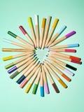 Potloden en hart Stock Afbeelding