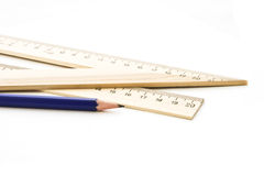 Potlood en heerser met een driehoek. Stock Foto