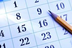 Potlood op een kalender stock afbeelding