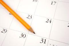 Potlood op kalender royalty-vrije stock afbeelding