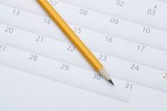 potlood op kalender Royalty-vrije Stock Afbeeldingen