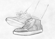 Potloodschets van voeten in gymschoenen Stock Afbeeldingen